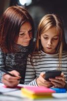Mother and daughter using smart phone